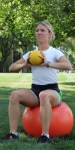Toss medicine ball back and forth while sitting on a physioball, maintaining pelvic positional control